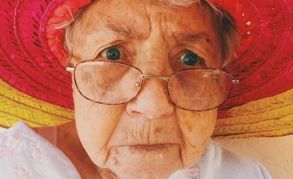 older aged woman with glasses on